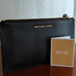 Michael Kors Bags - NWOT Michael Kors Jet Set Leather Clutch